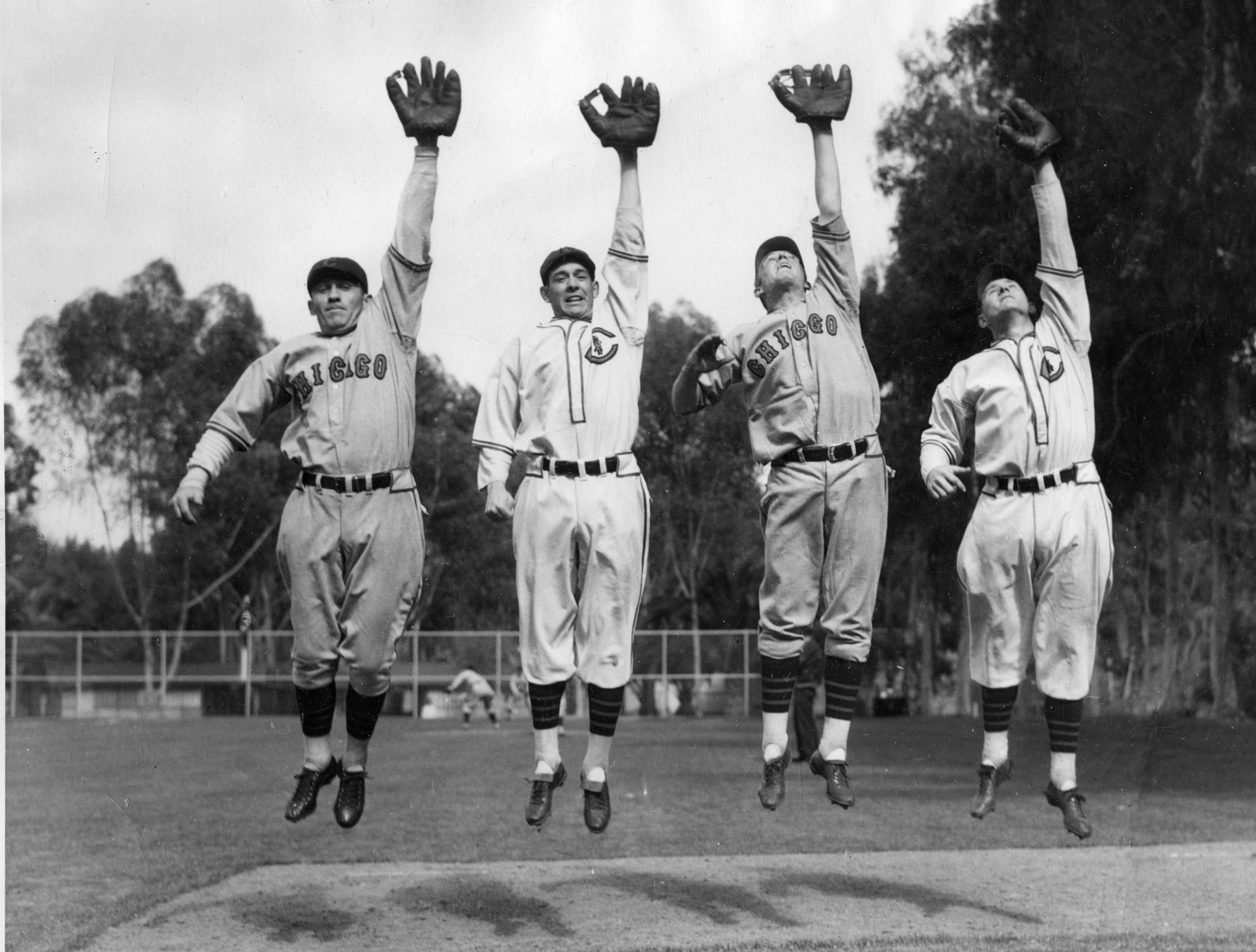 Frank Demaree, seen here on the far right in spring training with the Cubs in 1935, along with Kiki Cuyler, Augie Galan, and Tuck Stainback.
