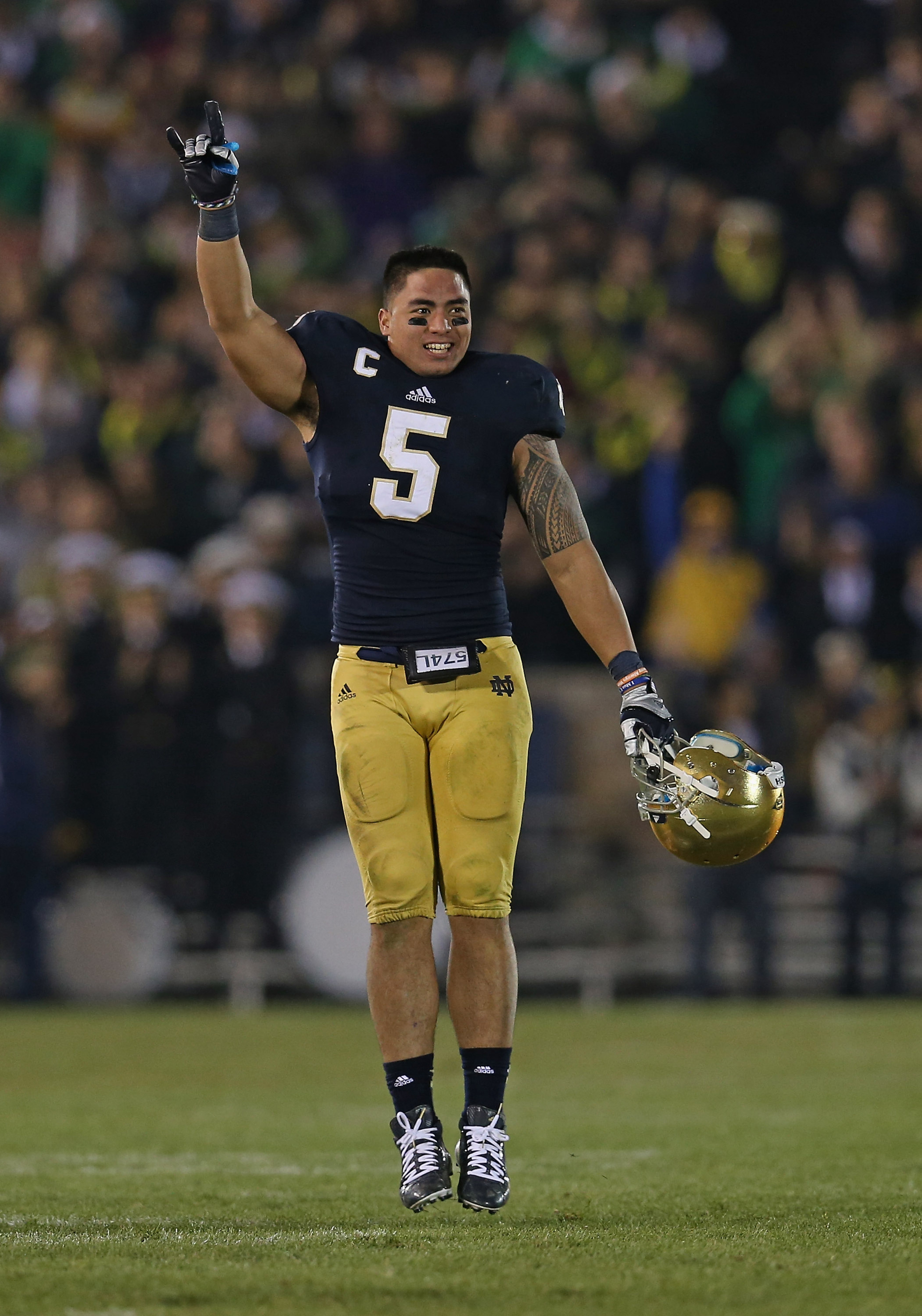 Manti T'eo holds up two fingers because even he doesn't believe Notre Dame is the best team in the country