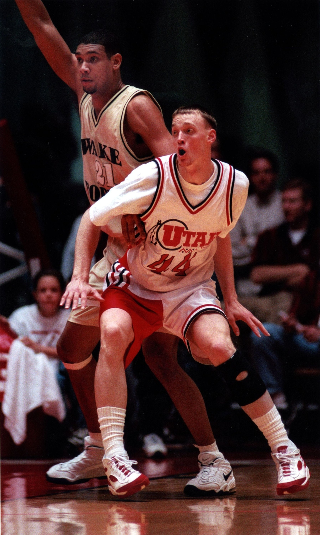 Runnin' Utes all-time leading scorer Keith Van Horn (shown here guarding former Wake Forest star Tim Duncan) is an all-century teamer and has his jersey retired and hanging in the Jon M. Huntsman Center.