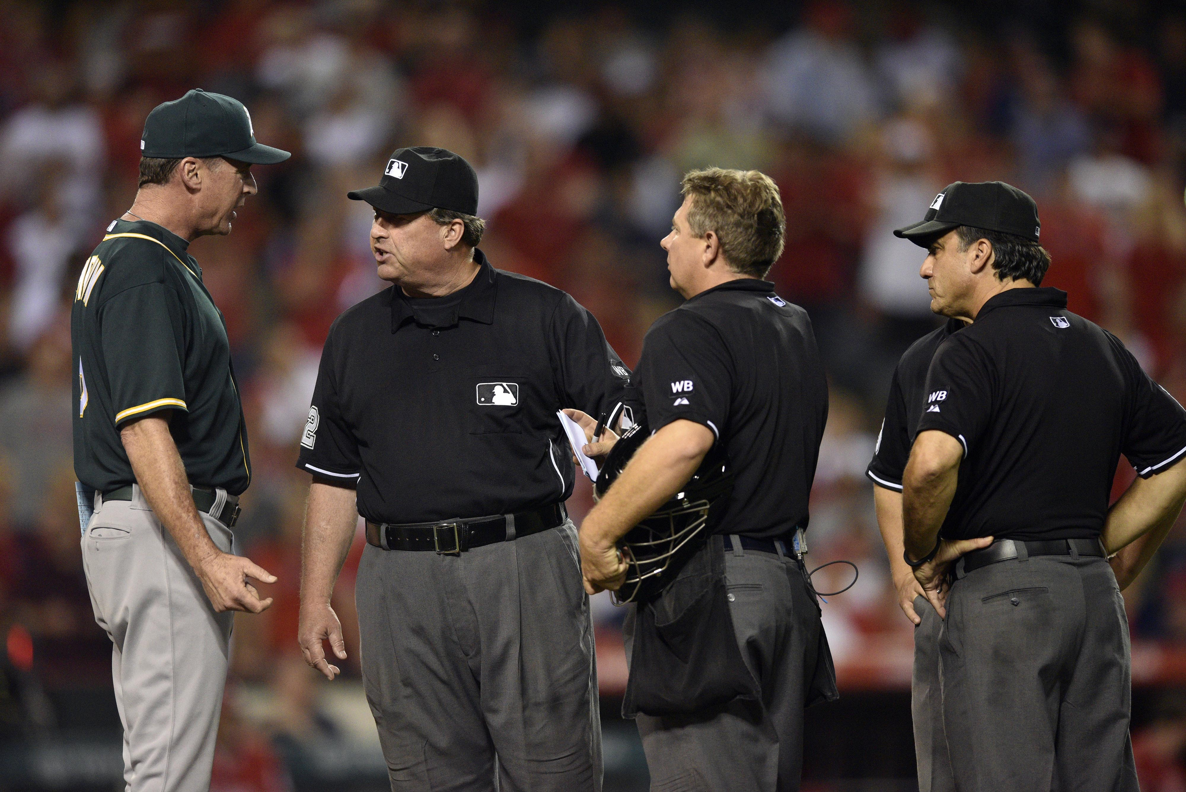 Angels beat Athletics, Oakland protests game after obstruction call