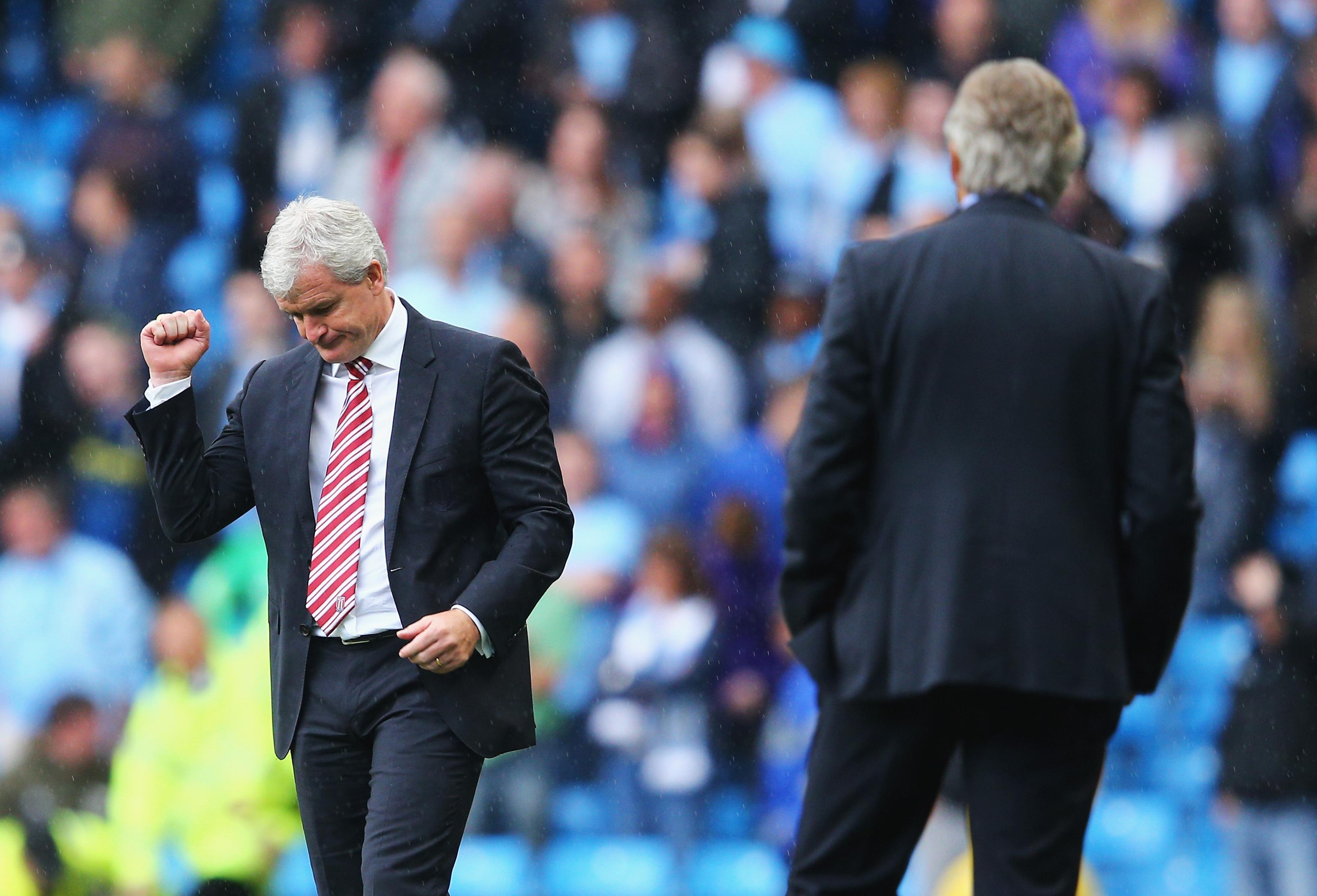 Former City manager, Mark Hughes, celebrates Stoke City's opening goal.