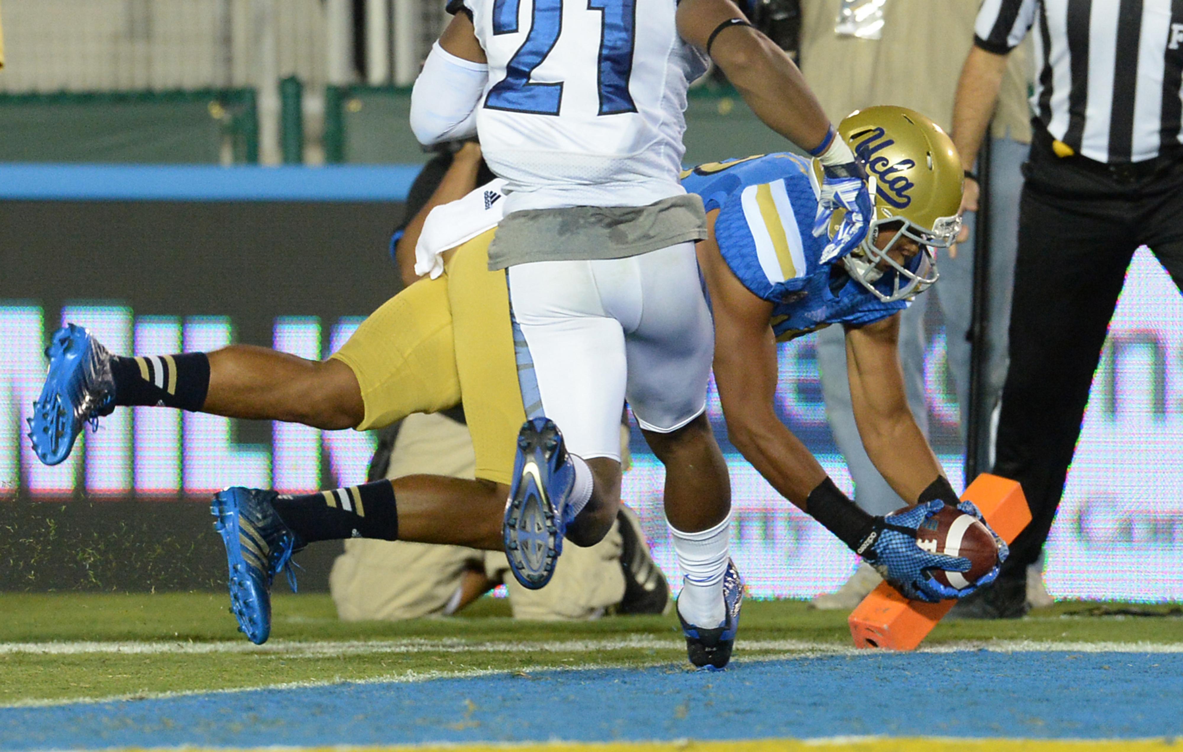Thomas Duarte almost scores his third touchdown.
