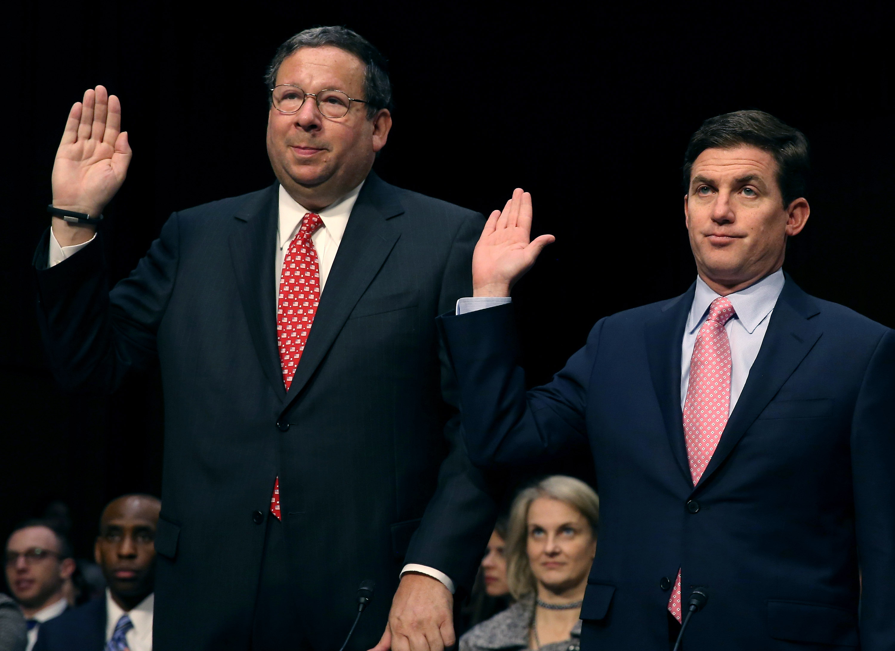 Executives for two of the least popular companies in America: David Cohen of Comcast and Arthur Minson of Time Warner Cable.