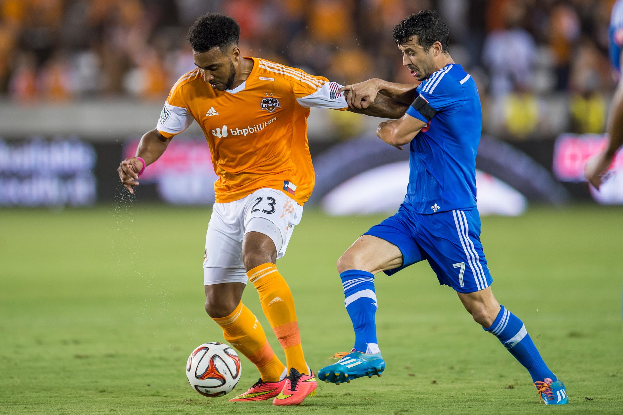 Giles Barnes battles against Felipe Martins as the Dynamo beat the Impact 3-2 on September 6th.