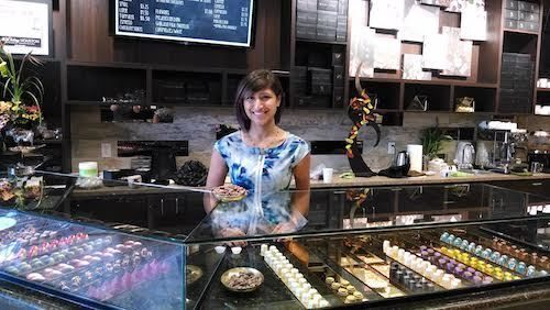 Owner Annie Rupani behind the counter at Cacao & Cardamom.