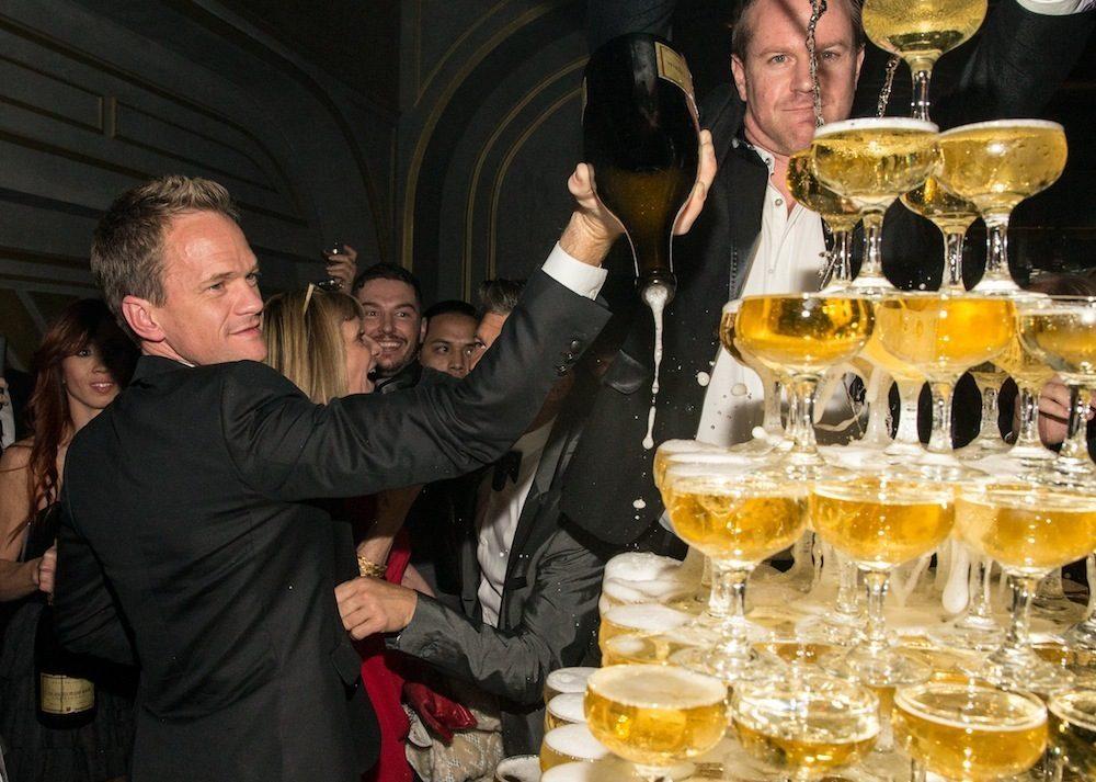 Yes, that's Neil Patrick Harris pouring magnum bottles of Louis Roederer Brut Premier over Rose.Rabbit.Lie.'s 500-coupe glass champagne tower. Photos: Erik Kabik