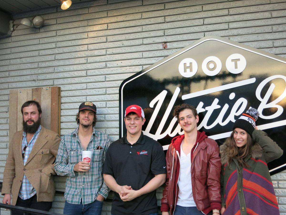 ShaneCody, Zak Appleby, Matt Myers, and Kate Toupin with their host at Hattie B's.