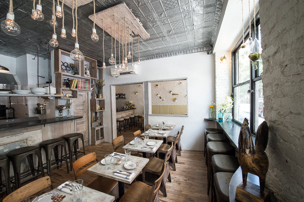 """<a href=""""http://ny.eater.com/archives/2014/06/root_bone_mcinnis_and_booths_new_southern_spot.php"""">Root &amp; Bone, NYC</a>"""