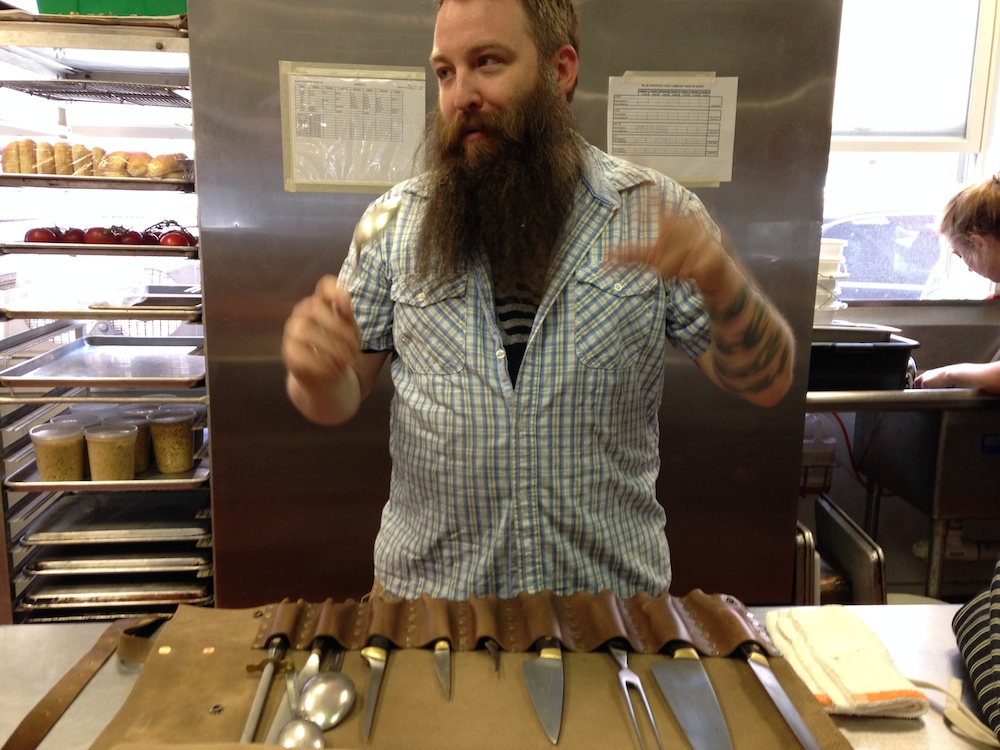 Erik Desjarlais with a Weft & Warp knife roll.