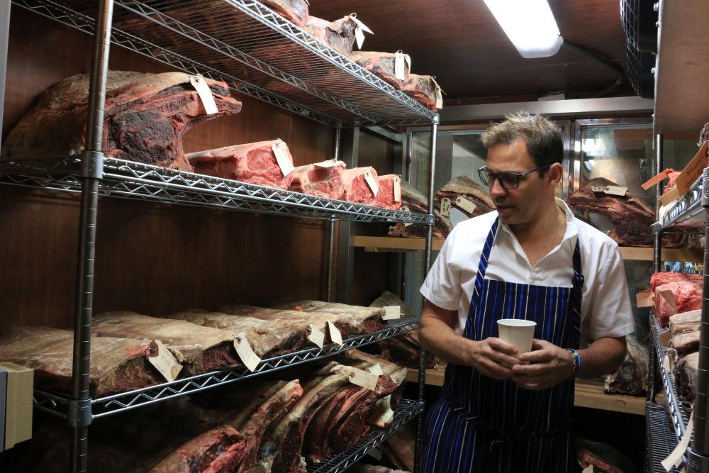 John Tesar checks up on his beef.