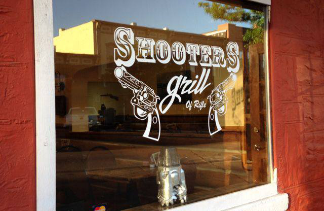 The Waitresses Pack Loaded Guns at Shooters Grill in Rifle, Colorado