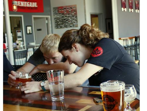 Ali Benetka tasting her first beer on tap at Renegade