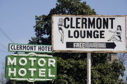 """<a href=""""http://www.flickr.com/photos/bobbyboi/424578427/"""">Clermont Hotel and Lounge signs</a>."""