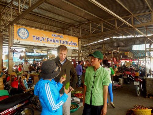 Braden Wages shops for vegetables at a Mekong Delta market.