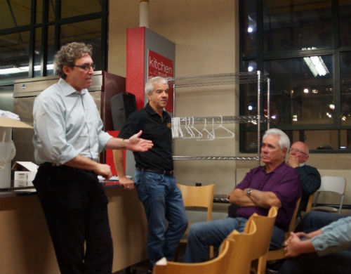Minnesota Food Truck Association President John Levy (left) and Downtown Food Committee President Doug Sams (right) talk to food truck owners Tuesday night for a possible solution to end the feud