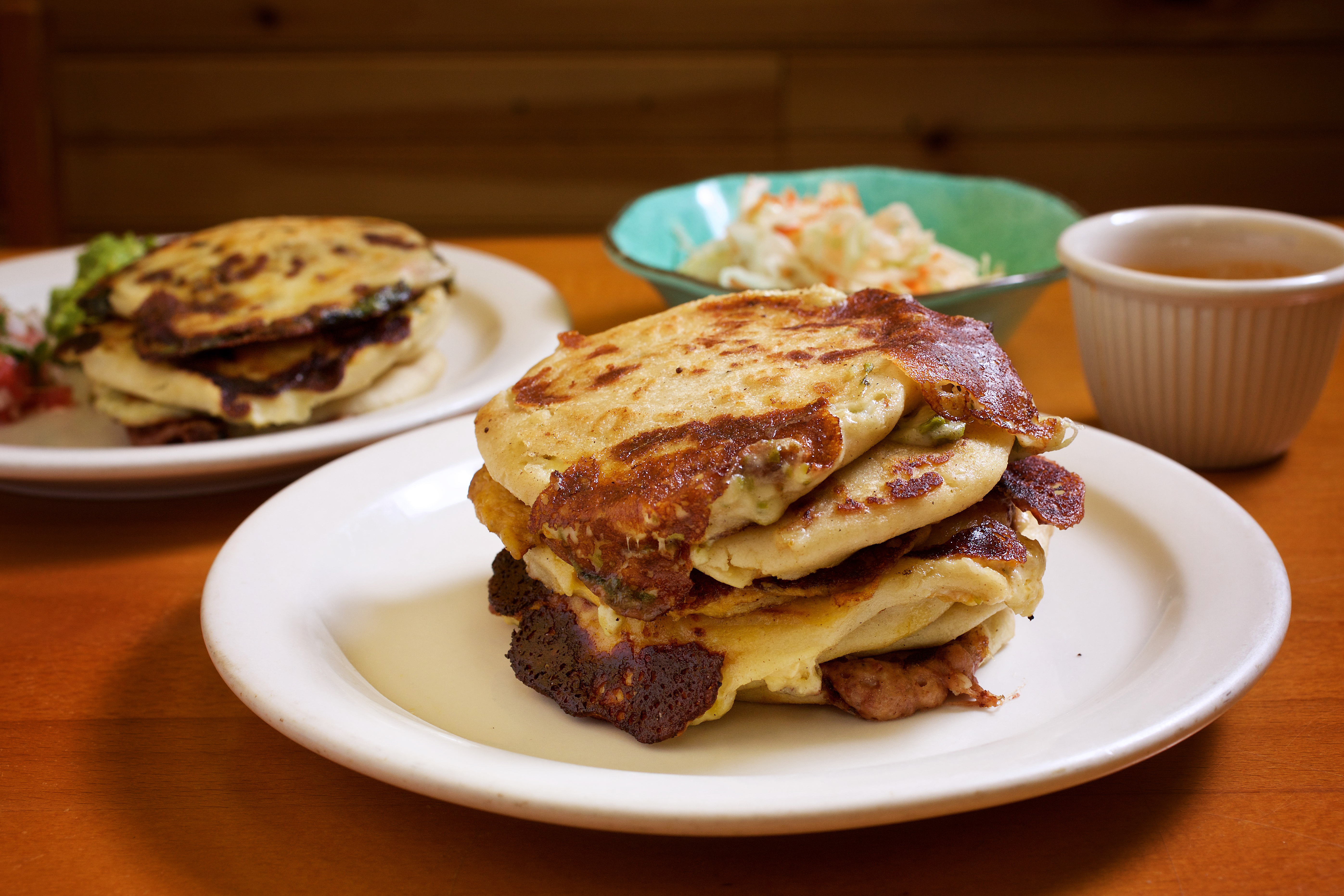 Pupusas overflowing with cheese and beans from Comedor y Pupuseria San Alejo
