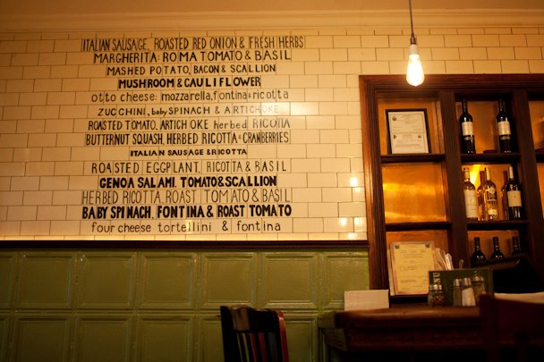 The pizza menu wall at Otto/Enzo in Portland's Arts District.