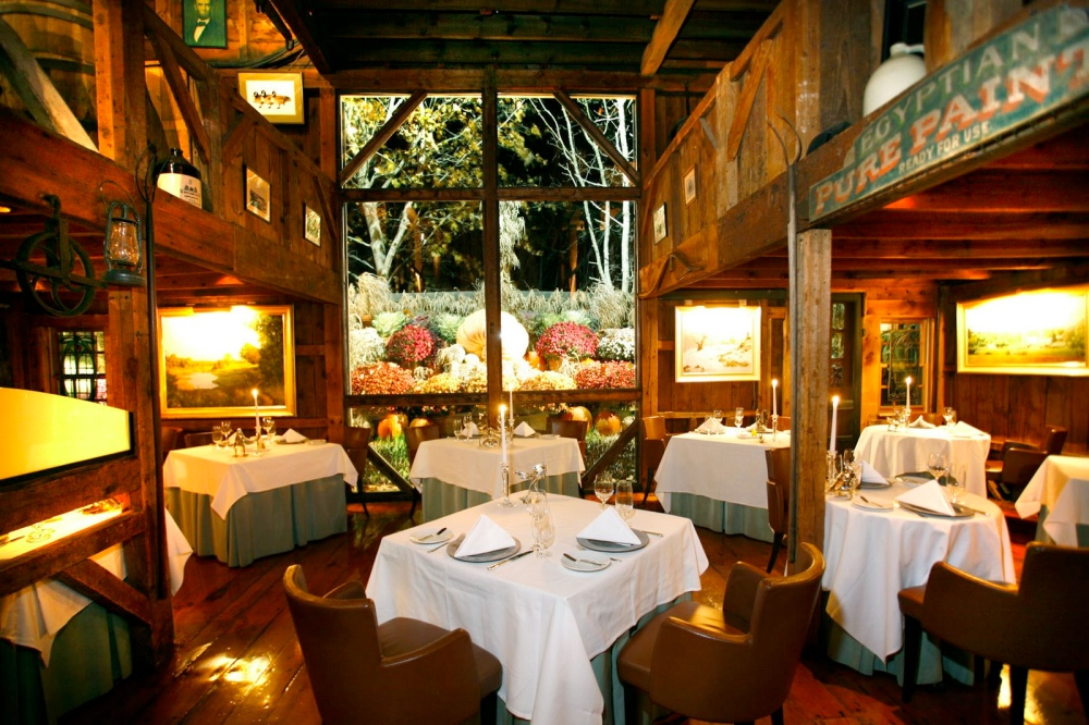 The iconic first barn dining room at the White Barn Inn.