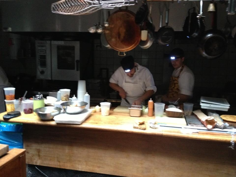 """The chefs at Tertulia kept on cooking through the storm, aided by some stylish headlights [Photo: Tertulia via <a href=""""http://www.facebook.com/photo.php?fbid=373742689366795&set=pb.152149768192756.-2207520000.1351982351&type=3&theater"""">Facebook</a>"""