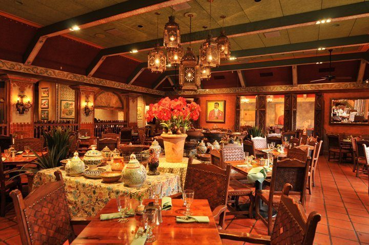 Fonda San Miguel's dining room, decorated with a rotating selection of authentic Mexican art curated by owner Tom Gilliland, is lively and inviting, lending a certain old-world gravitas to every meal.