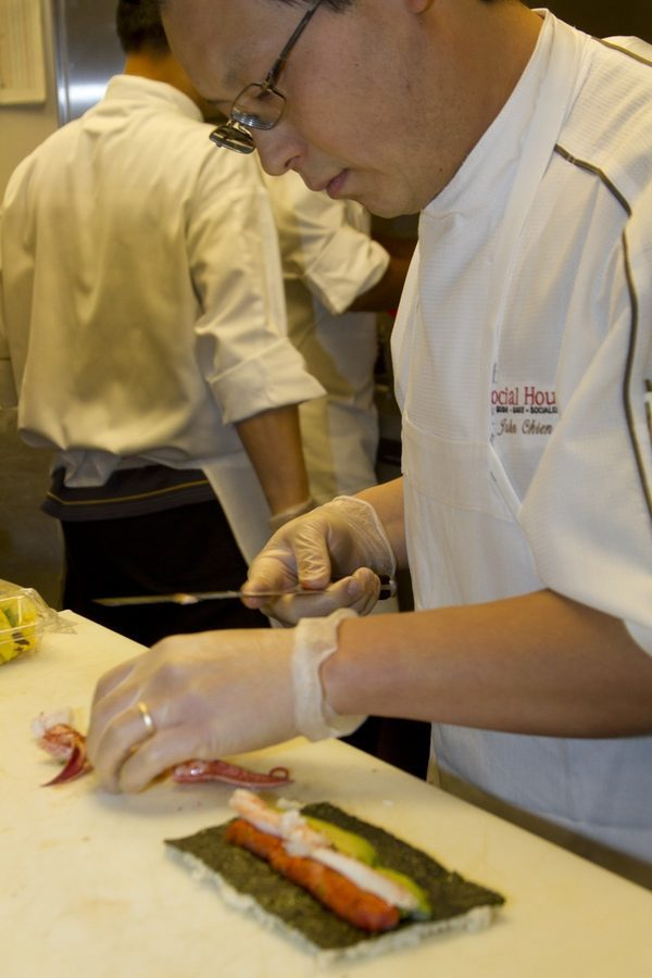 Social House executive chef John Chien Lee slices Alaskan King crab for the inside of the Ultimate Roll.
