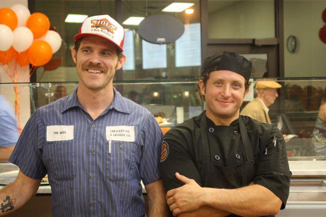 Bart Bell and Jeff Baron at the opening of Pizzicare last September.