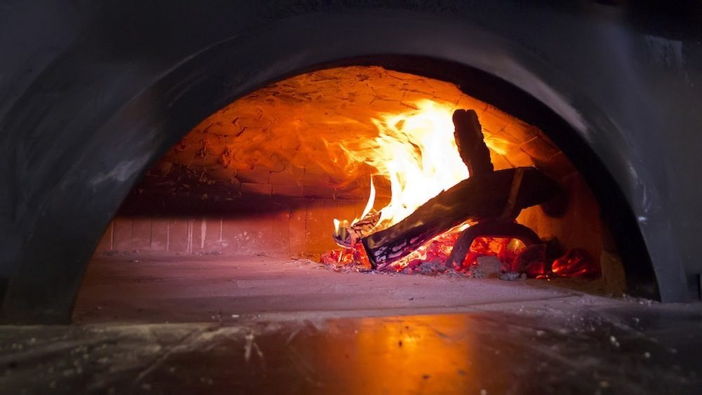 The fire rages inside the pizza oven, which has been lit since its installation. Sort of like the eternal flame, only for pizza.