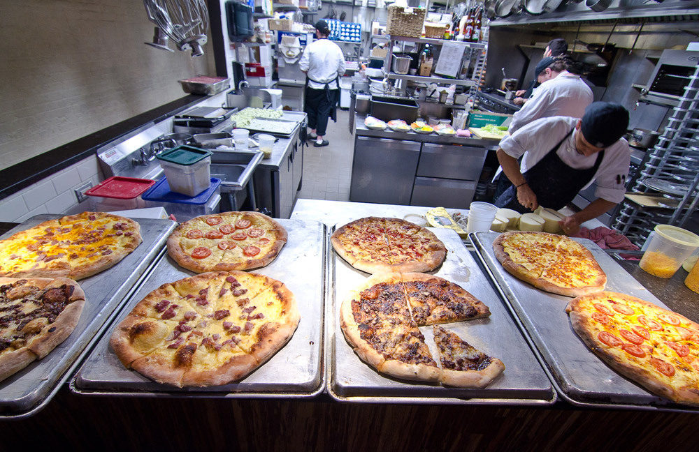 Every Monday, Birch & Barley cooks make 8-12 pizzas to feed 50-60 people during family meal.
