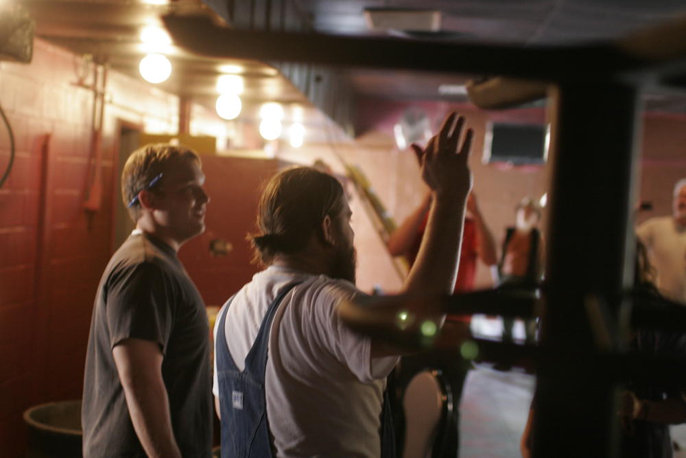 Denis O'Donnell directs a crew of friends and family last week, transforming Club La Trampa into The White Horse.