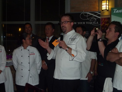 Christopher Koetke, Executive Director of Kendall College introducing the guest chefs.