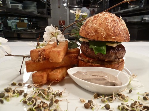 Sho Shaun Hergatt Burger: 5 oz shortrib burger with lamb bacon, truffle mayonnaise, carmelized onion and pickled ramp compote, tomato, and ramp leaves on a housemade brioche bun. It's offered for lunch and dinner in the Pearl Room and Black bar for