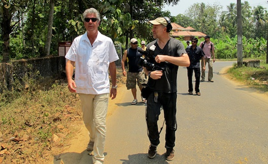 Bourdain and producer Chris Collins getting those walking shots.