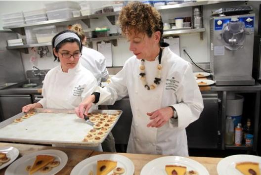 Nancy Silverton plates a pumpkin/date tart with bourbon ice cream.