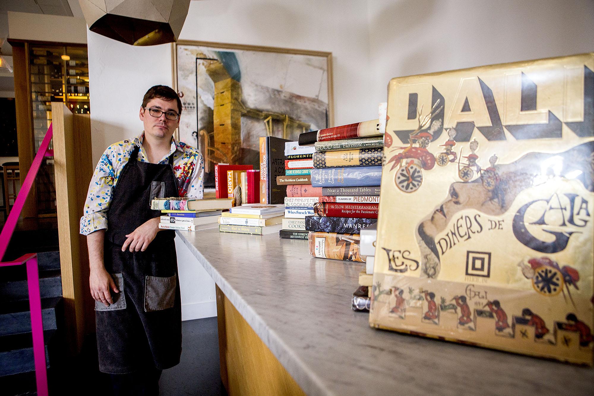 Stratton with favorite cookbooks at Vespolina.