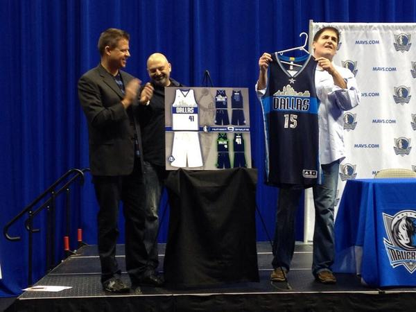 Geoff Case, right, submitted the winning bid for the new 2015-16 alternate jerseys.