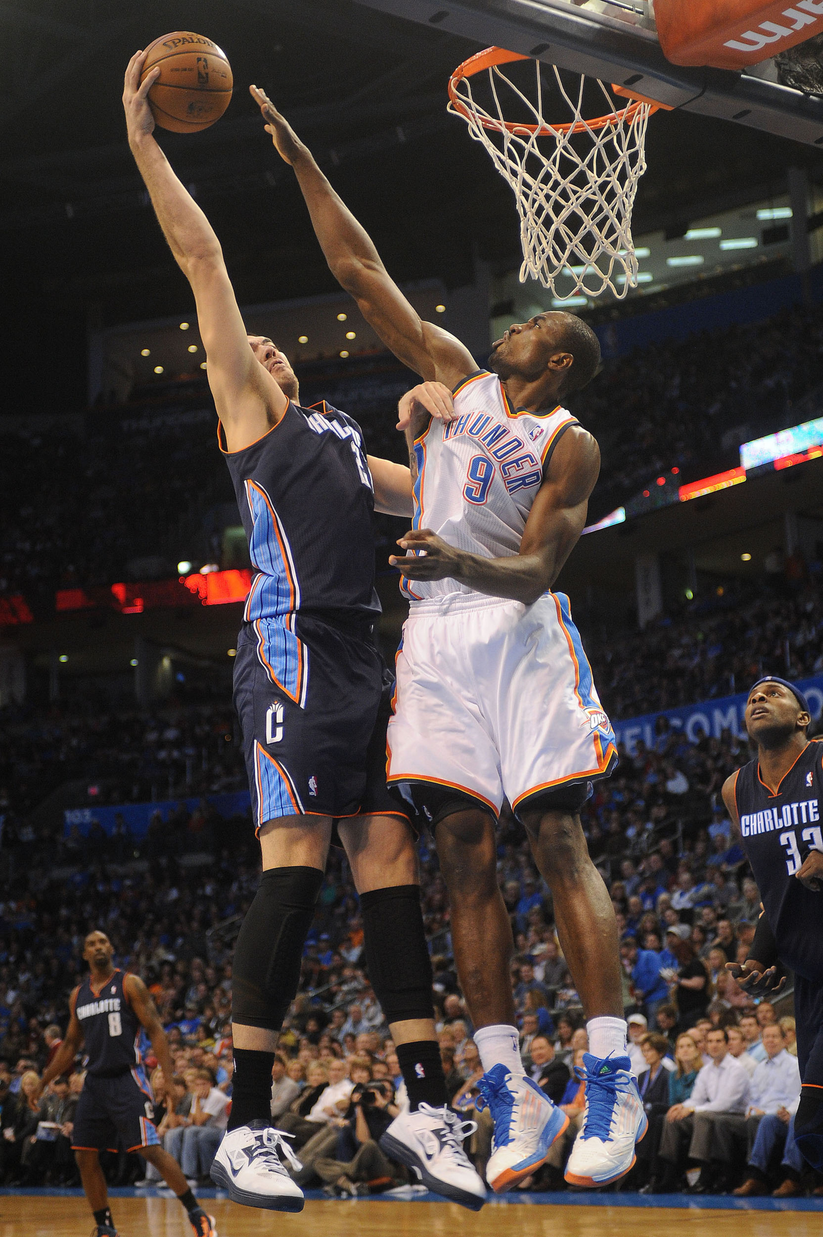 Former Thunder player Byron Mullens is defended by Thunder power forward Serge Ibaka.