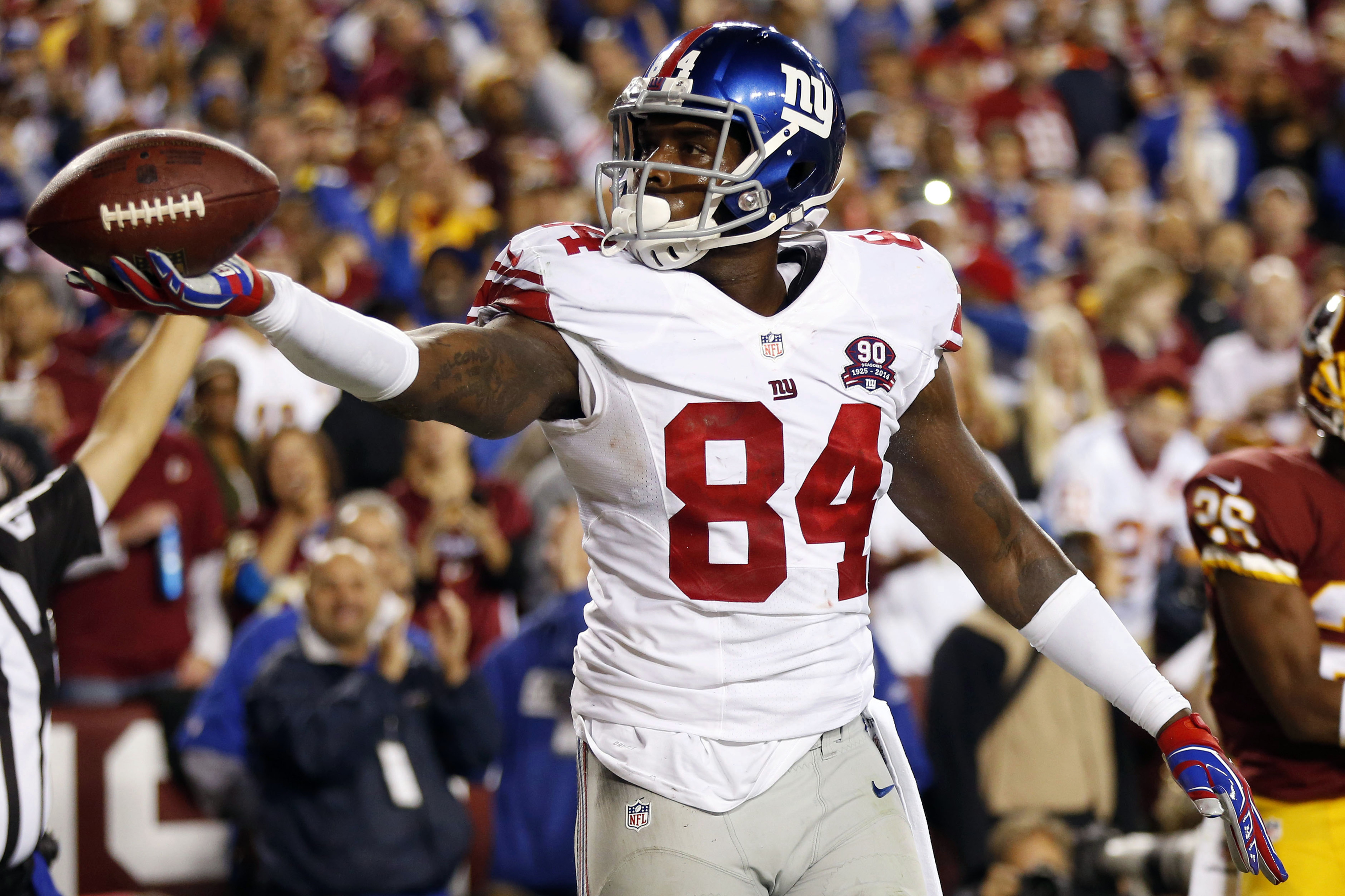 Larry Donnell celebrates one of his three touchdowns