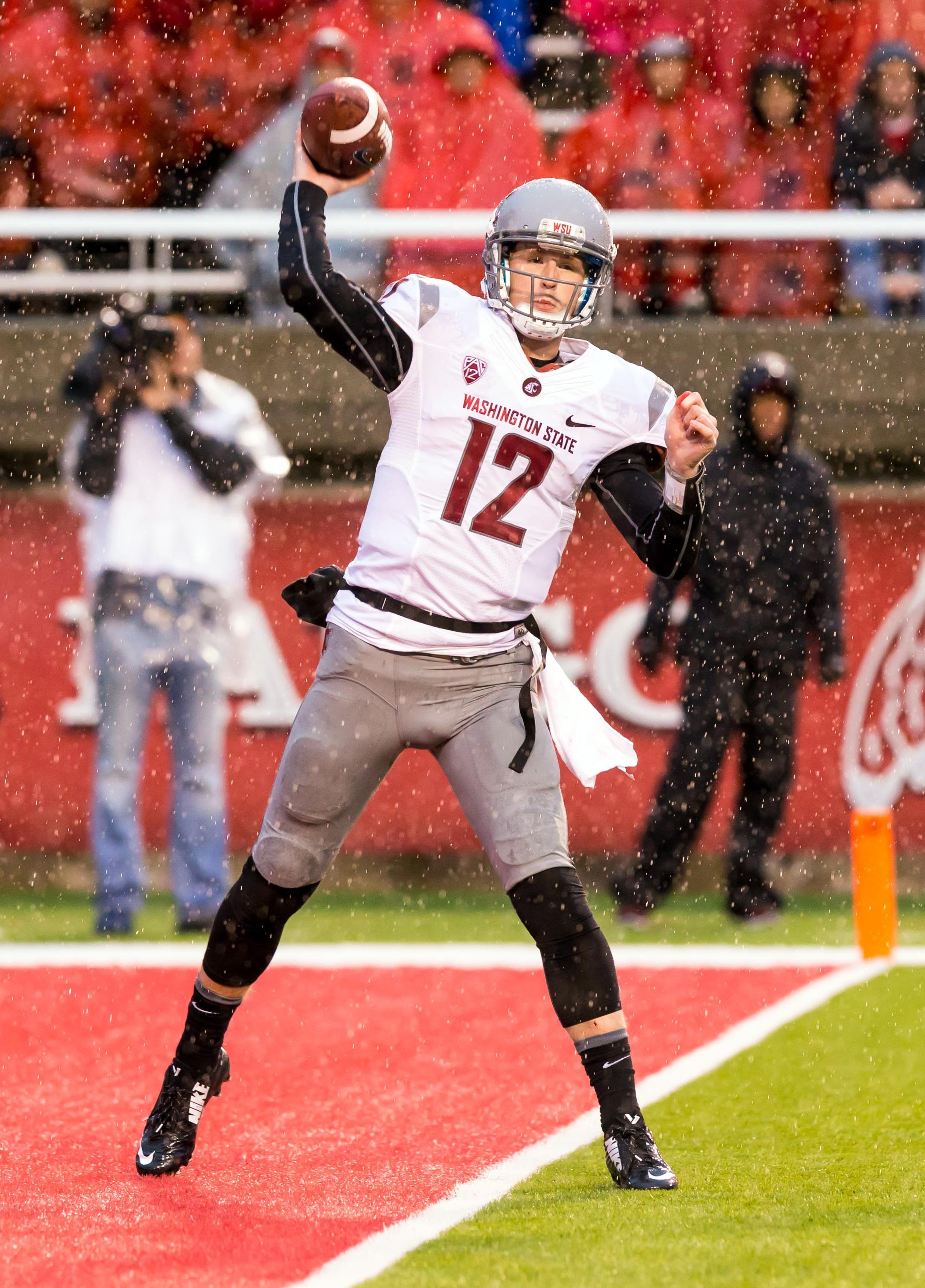 Despite the rain storm, Washington State quarterback Connor Halliday fired pass after pass to lead his Cougars to a 28-27 win over Utah in Rice-Eccles Stadium.