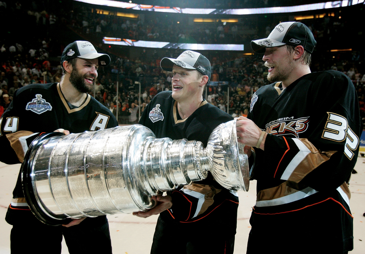 Rob Niedermayer, Samuel Pahlsson, and Travis Moen celebrate with the Stanley Cup in 2007.