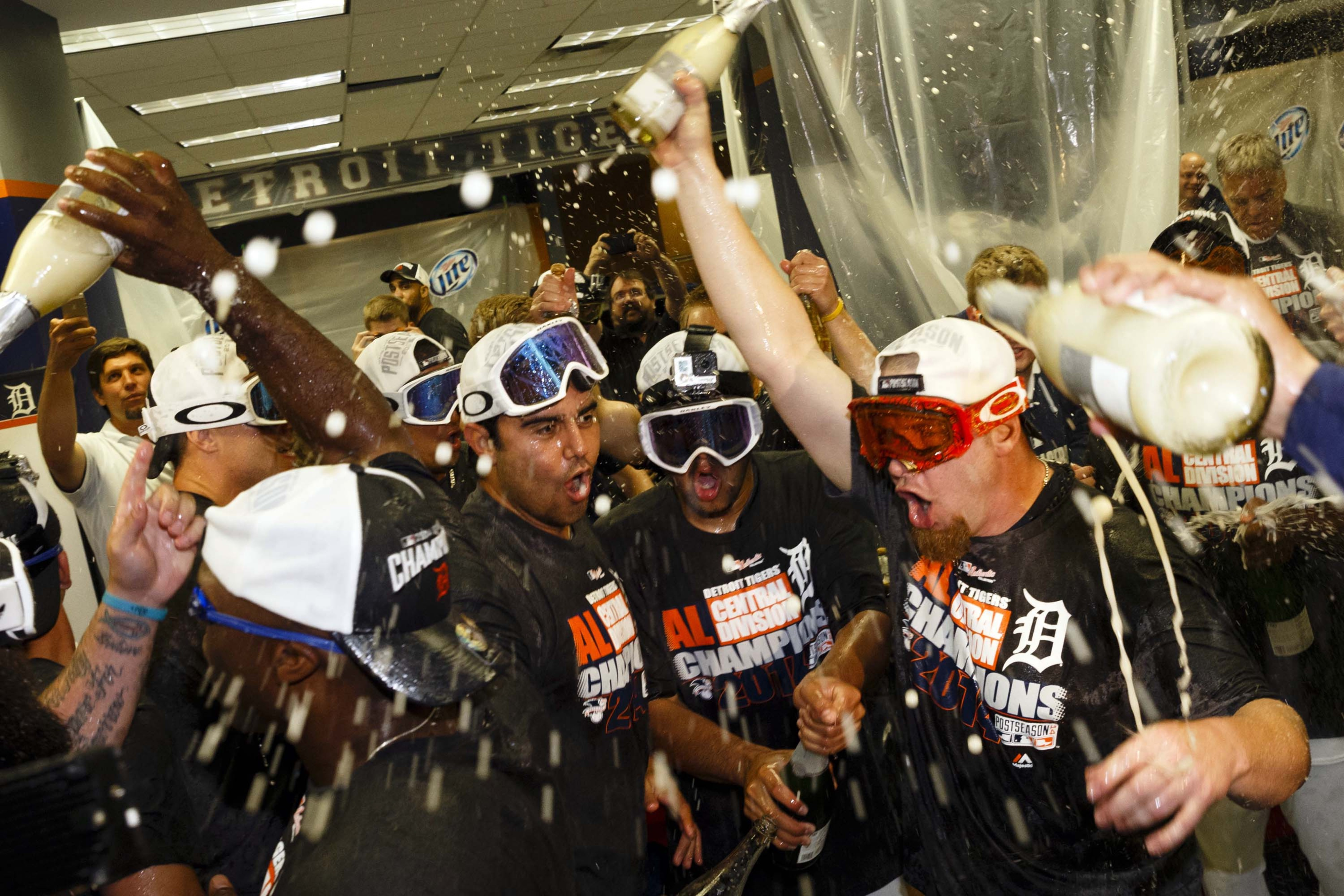 Detroit Tigers players celebrate after winning the Central Division Championship on September 28, 2014
