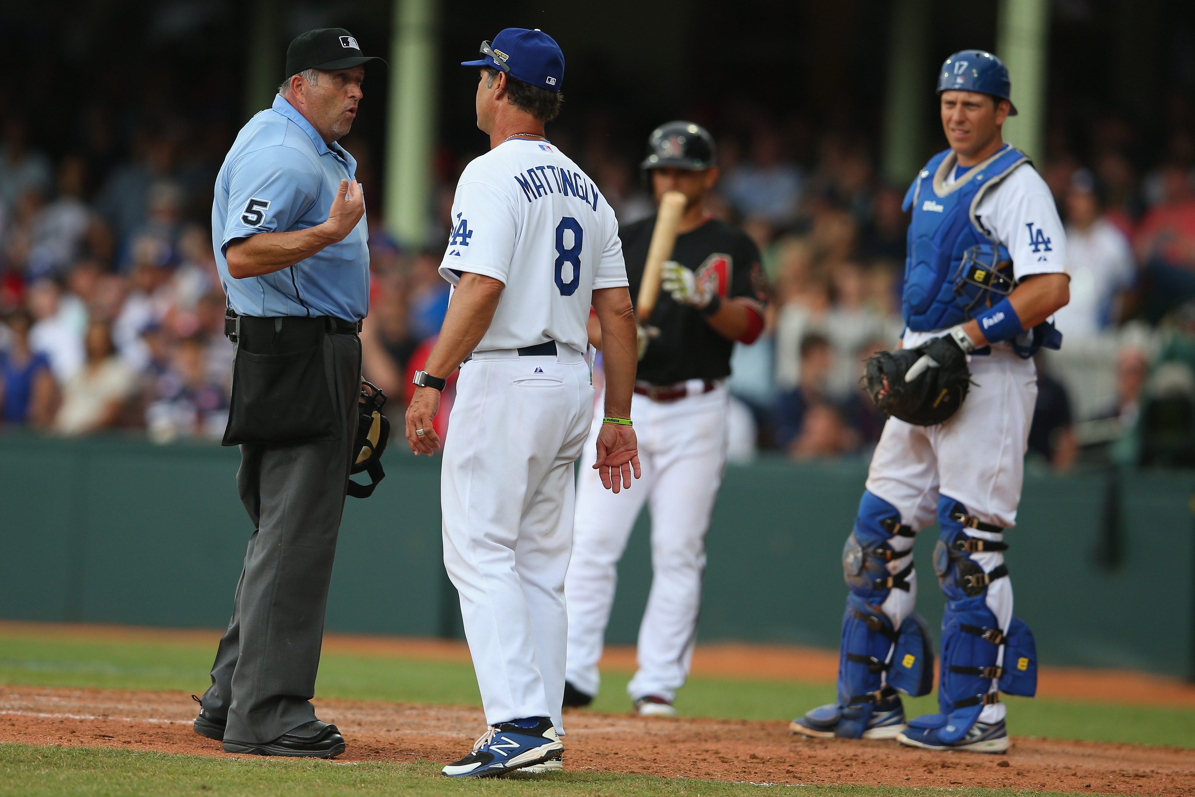 Dale Scott, seen here with Don Mattingly in March in Sydney, is the crew chief for the NLDS umpiring crew for the Dodgers-Cardinals series.
