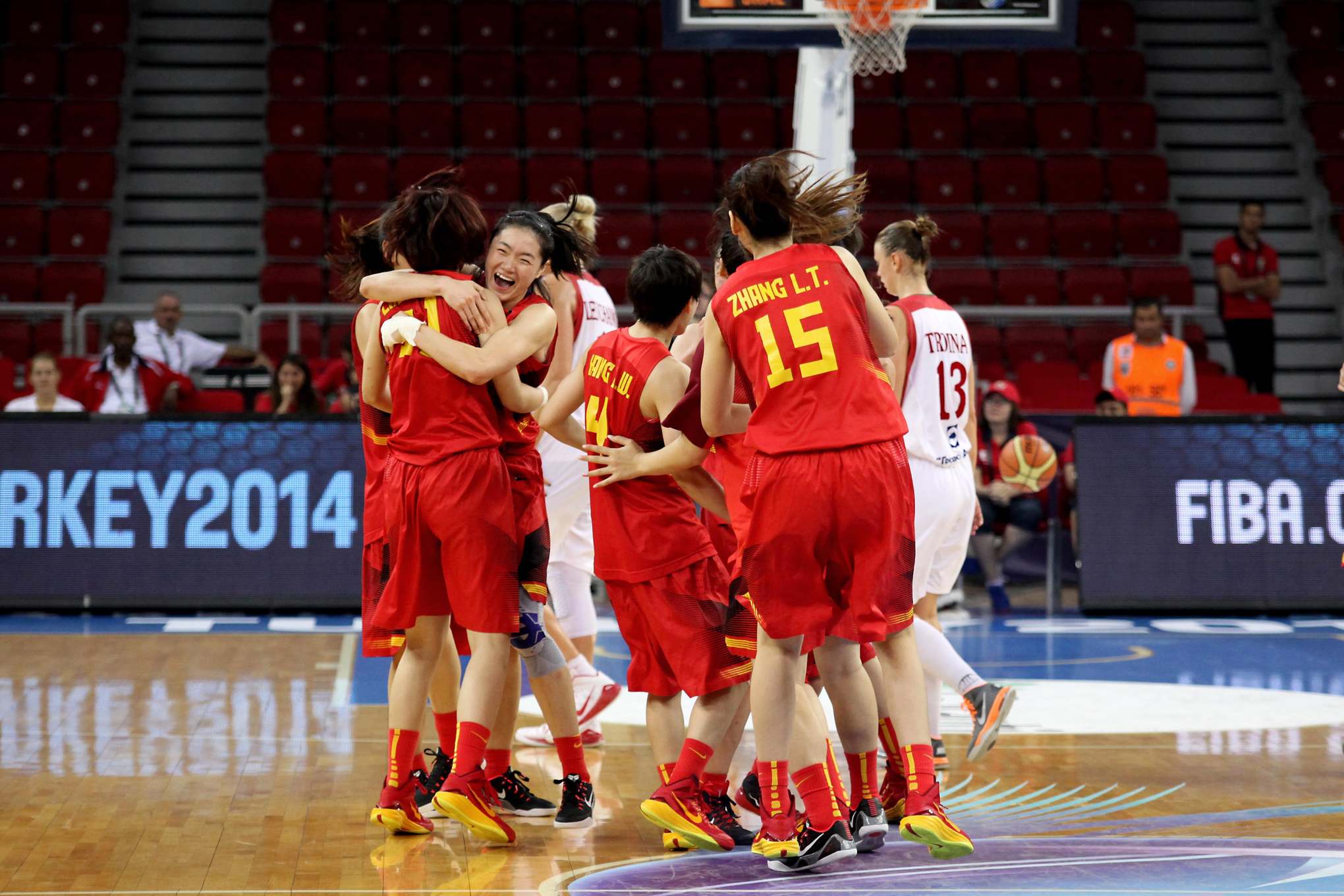 China celebrates after beating Belarus to advance to the 2014 FIBA World Championships for Women quarterfinals.