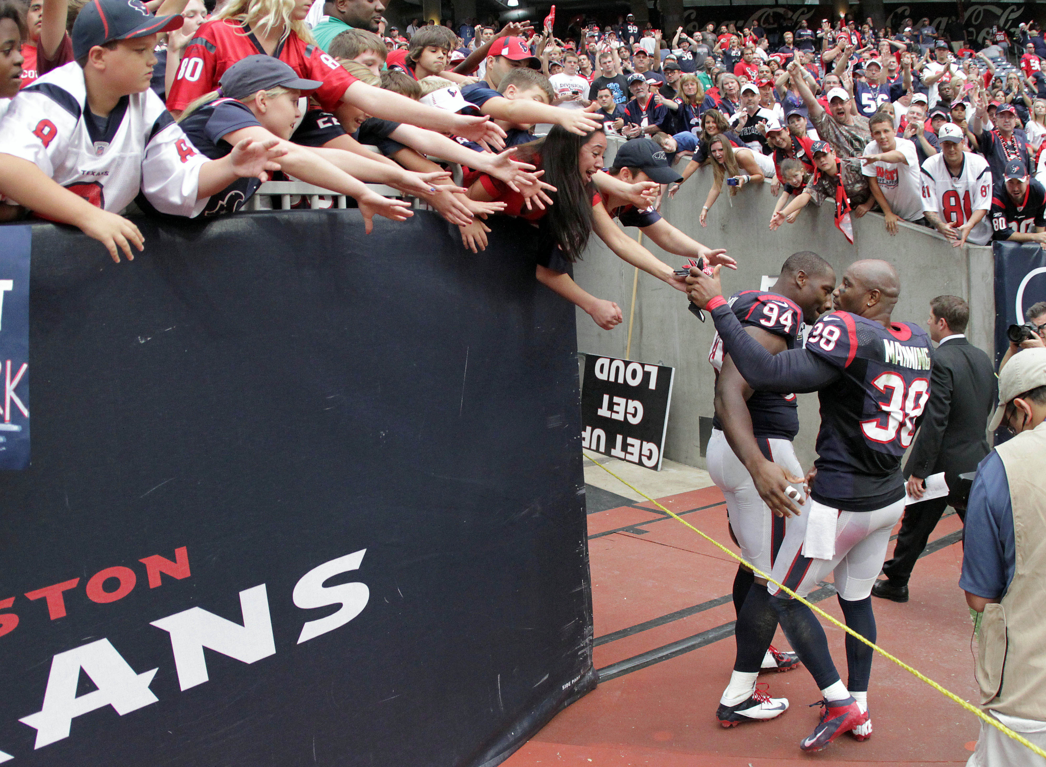 Danieal Manning, celebrating with fans after the last Texans' victory over Tennessee.