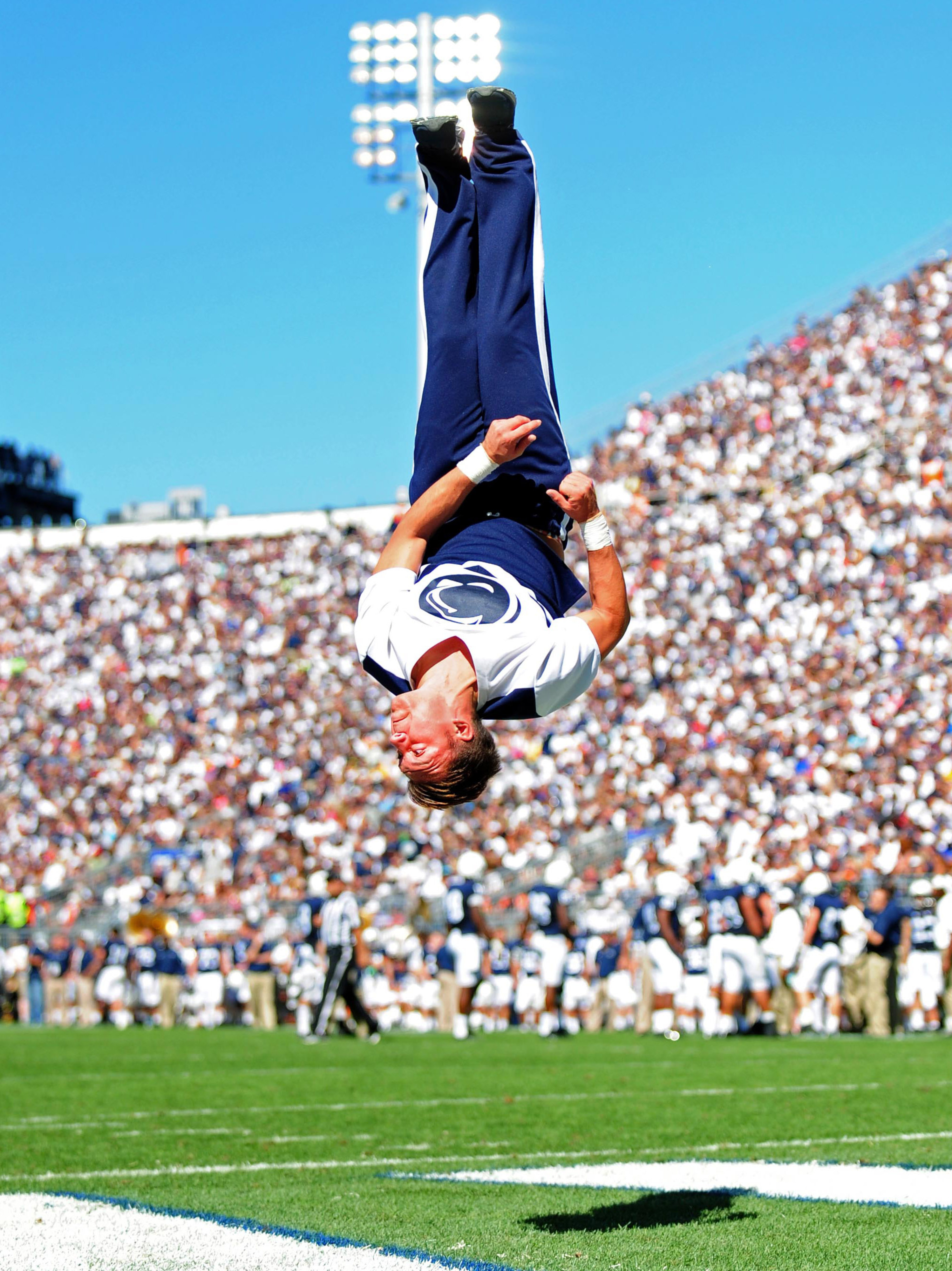 A Penn State cheerleader attempts to distract fans from a huge, embarassing, failure.