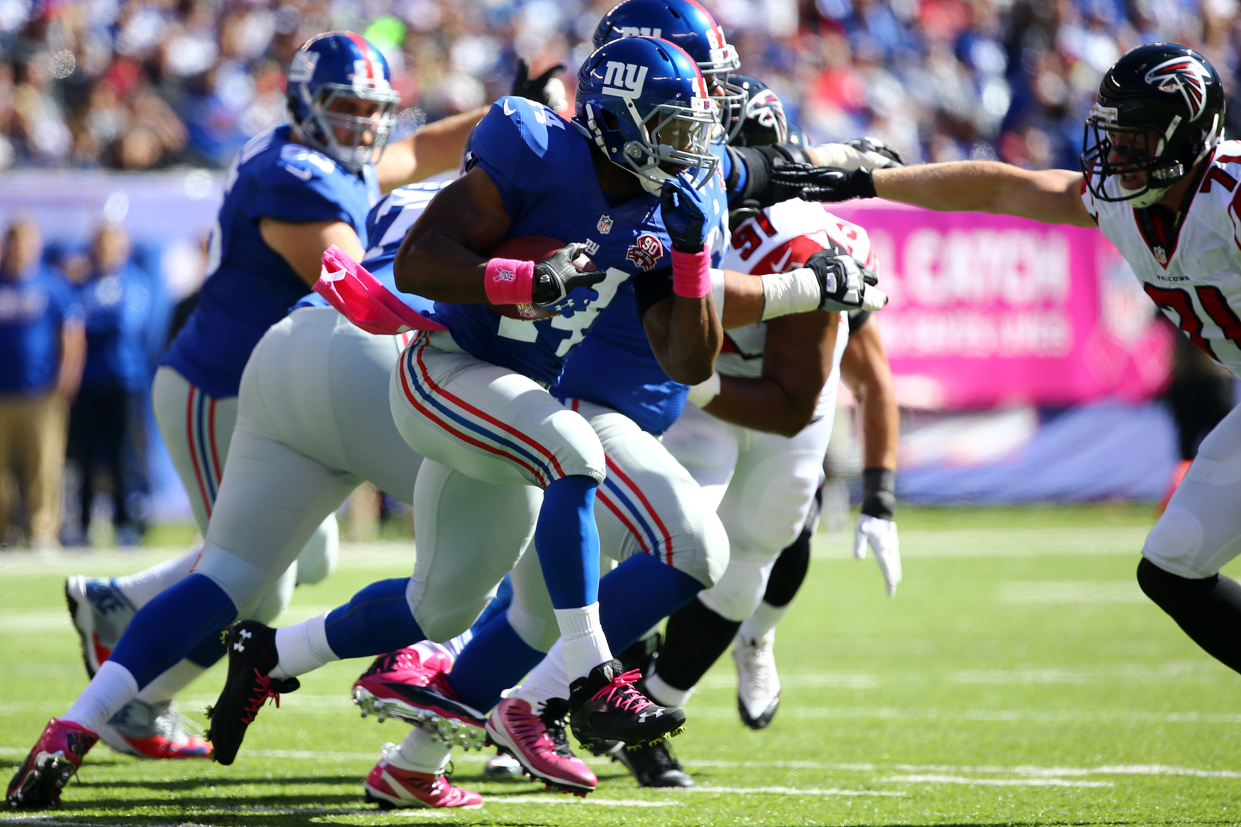 Andre Williams runs with the ball