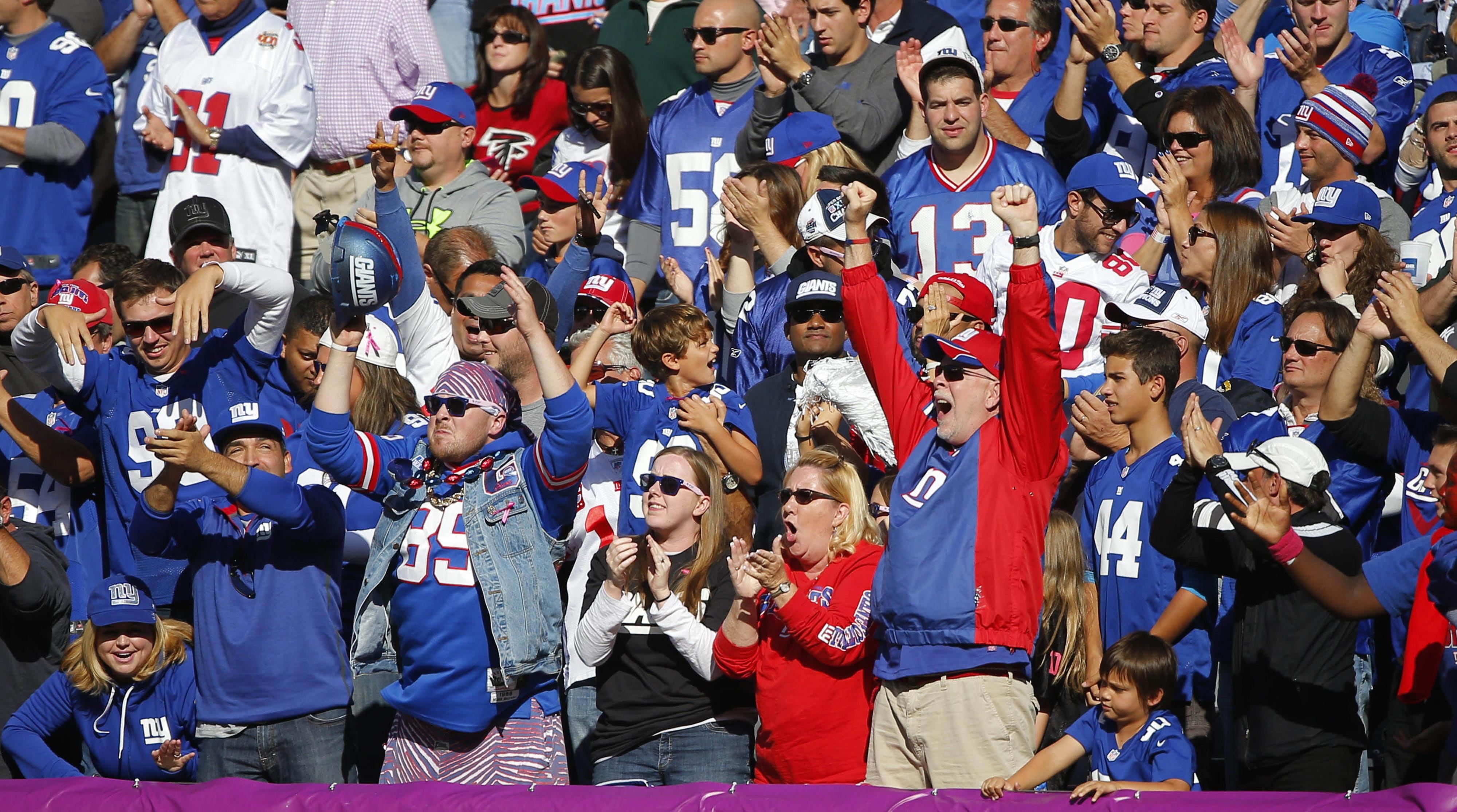 Giants fans celebrate Sunday at MetLife Stadium