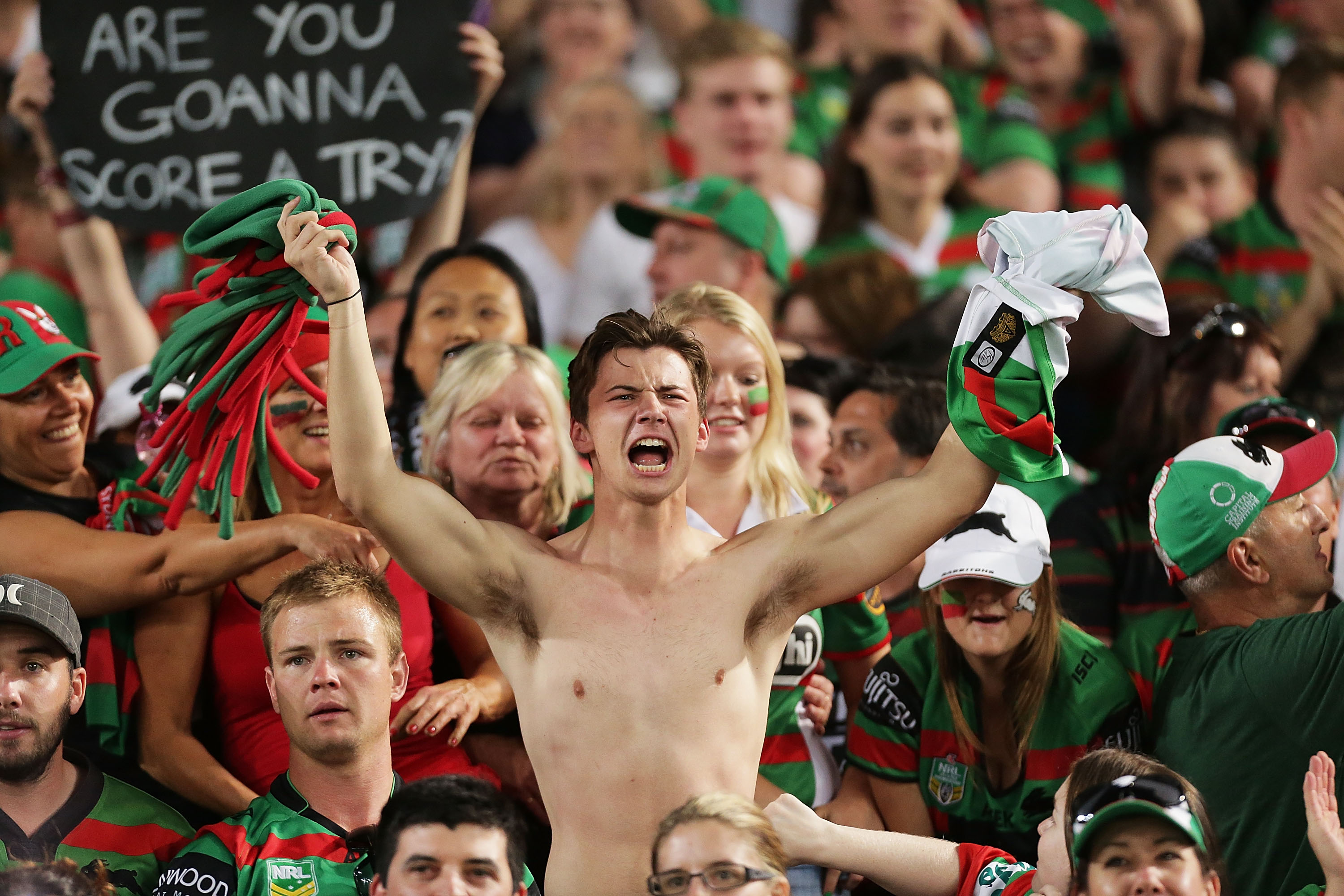 Rabbitohs fans celebrate their team's win.