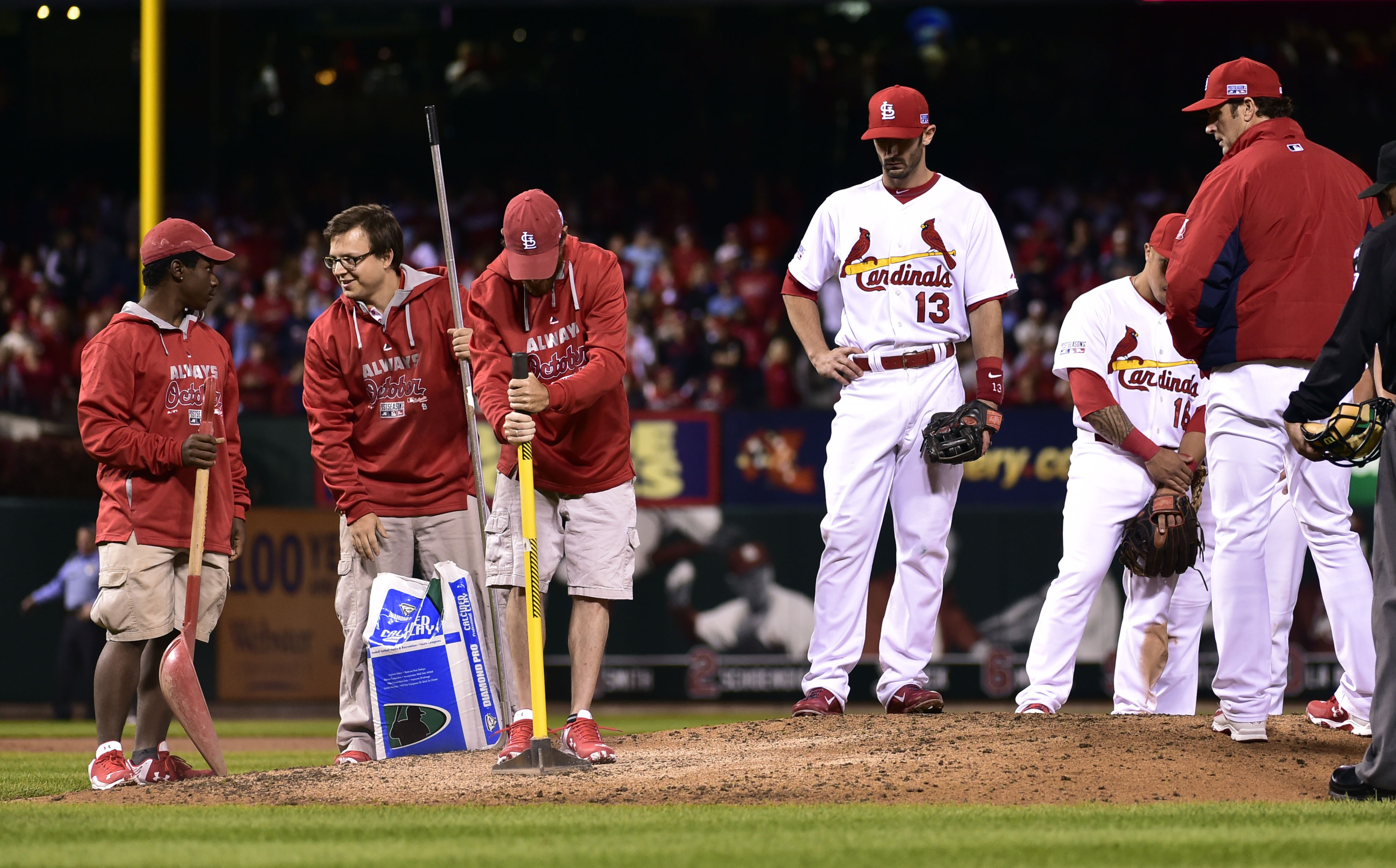 Matt Carpenter, coaches son, ensures the grounds crew is tamping that dirt correctly.