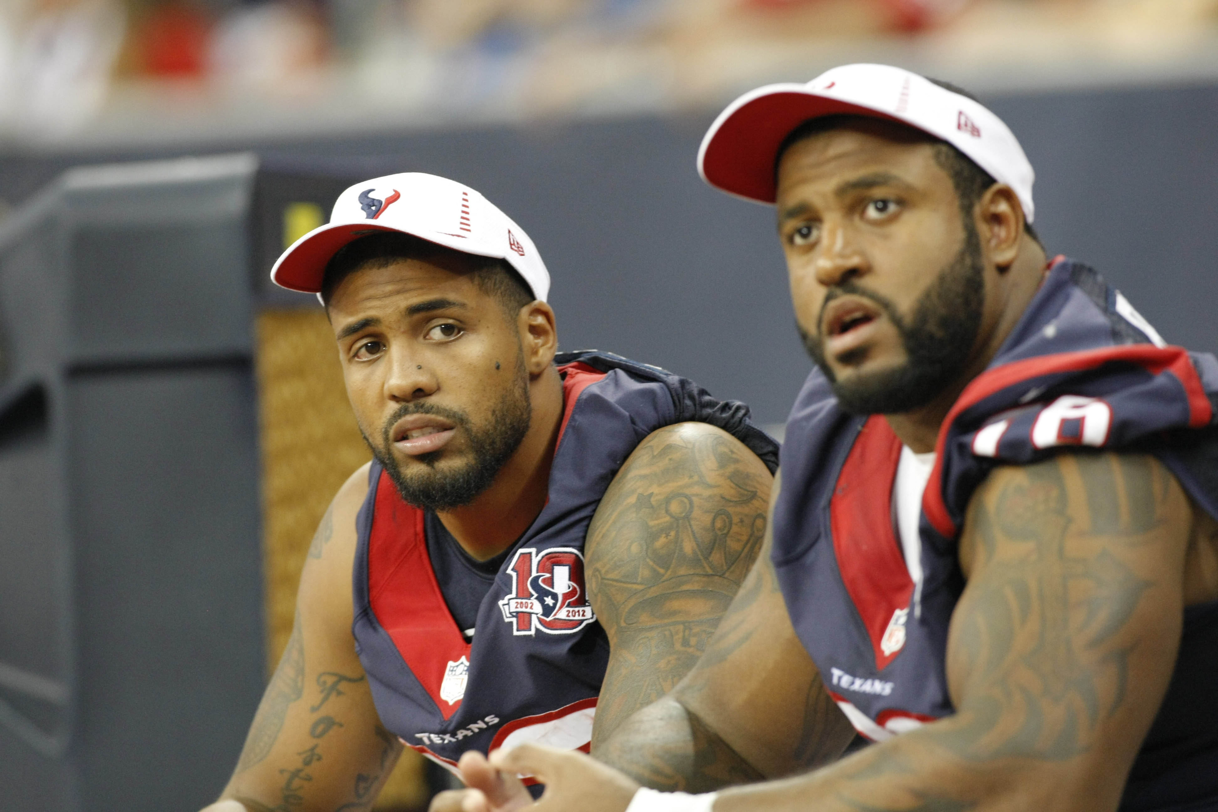 Brown and Foster doing their best impression of a Titans fan attempting a math problem