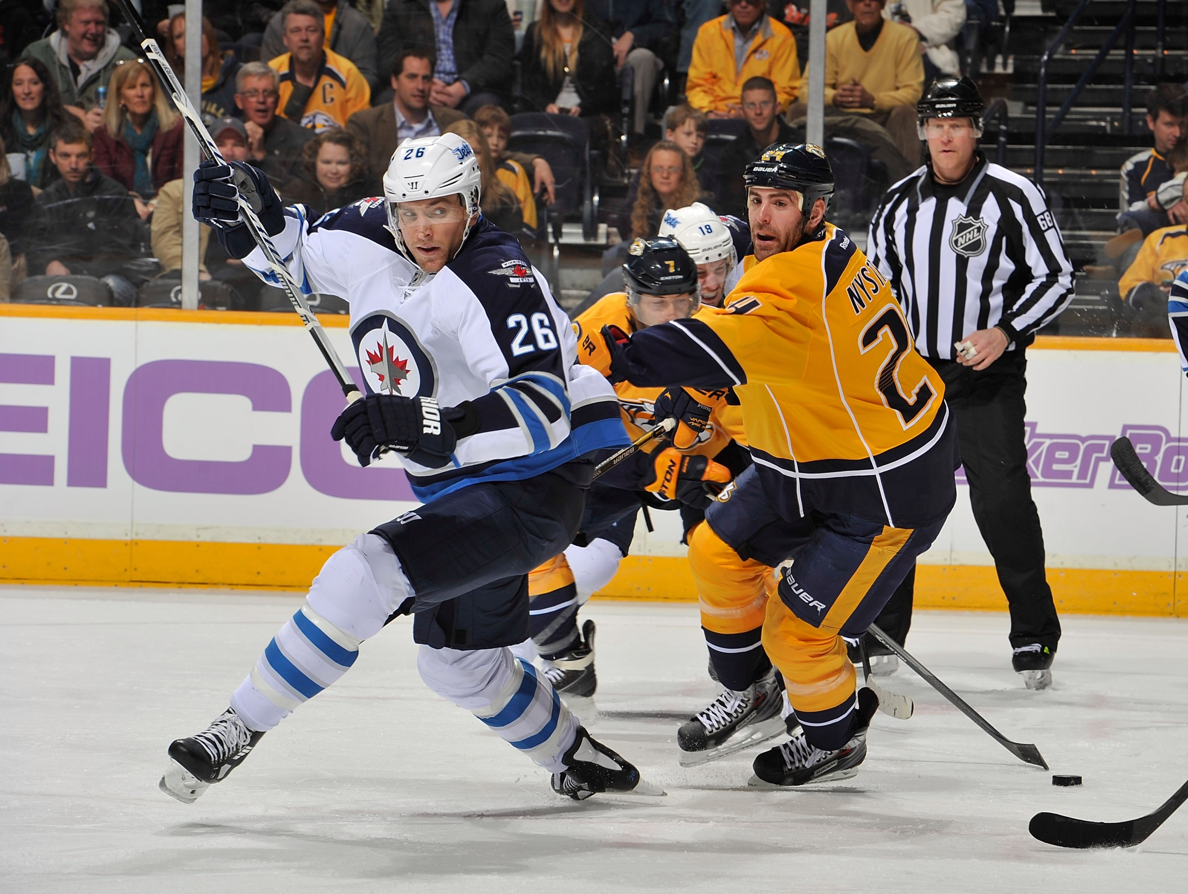 Blake Wheeler #26 of the Winnipeg Jets skates against Eric Nystrom #24 of the Nashville Predators at Bridgestone Arena on March 1, 2014 in Nashville, Tennessee. (Photo by Frederick Breedon/Getty Images)